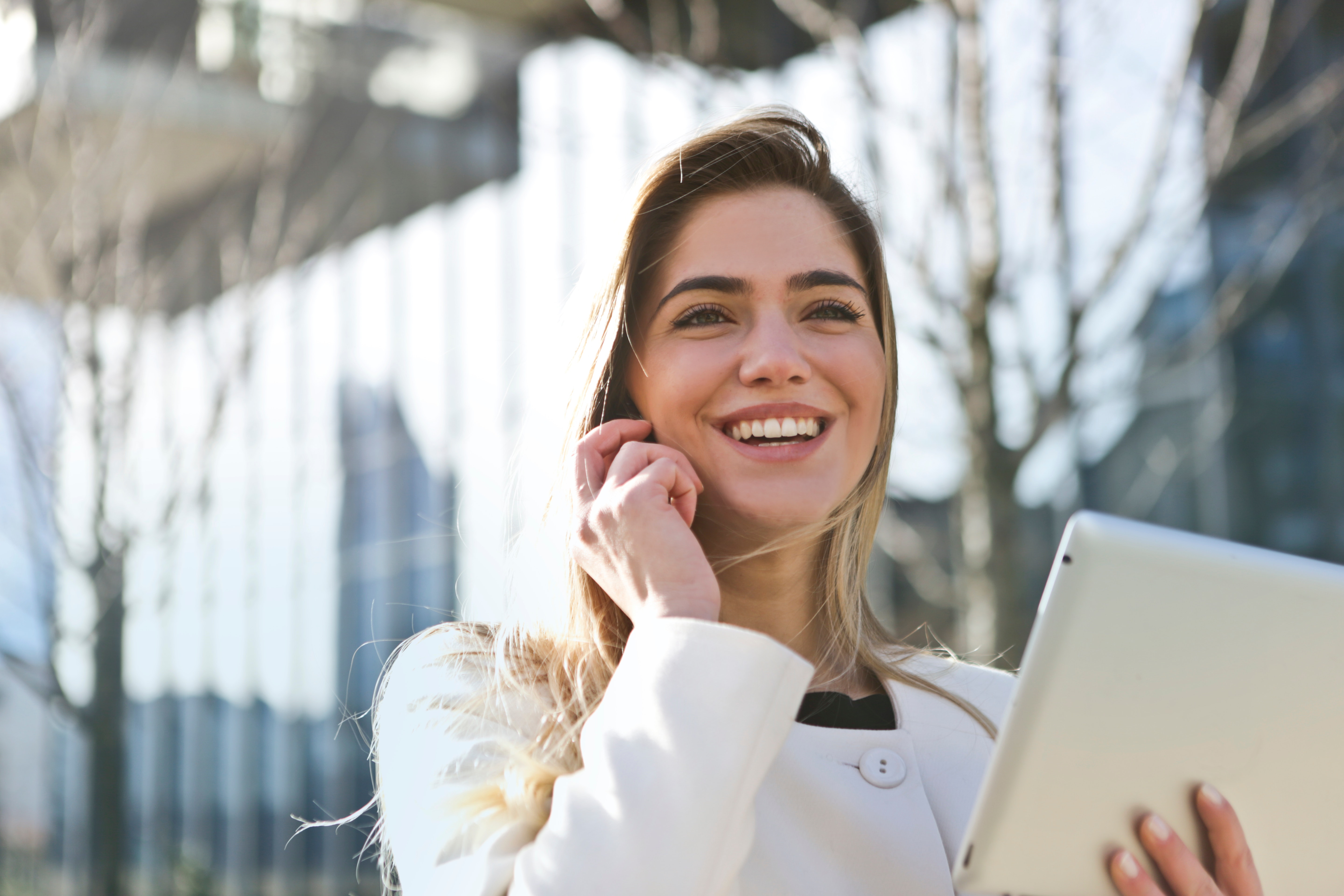 Blonde woman smiling on the phone